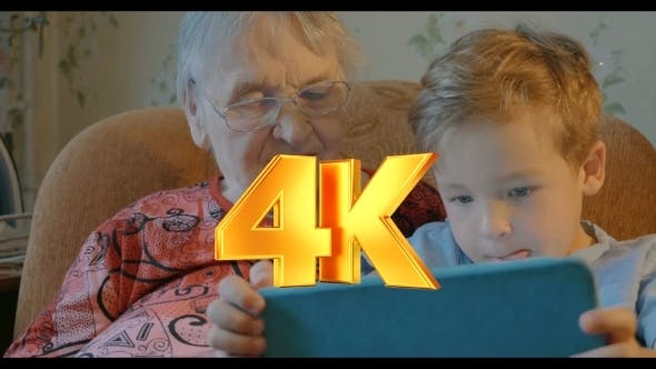 Thumbnail for Boy Showing Something In Tablet To His Grandmother
