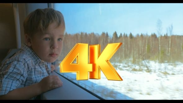 Thumbnail for Boy Looking Out The Window Of Moving Train