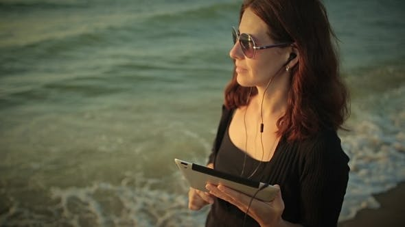Thumbnail for Woman Uses Tablet Pc At The Seaside