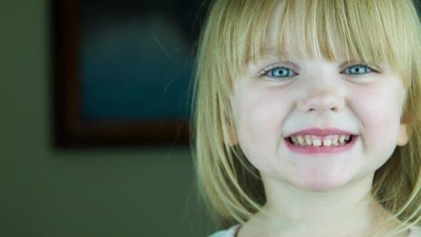 Thumbnail for The Little Cute Girl Sends An Air-kiss To The