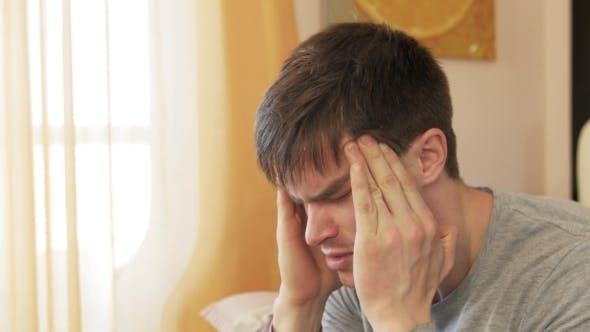 Thumbnail for Man Having a Headache At Home