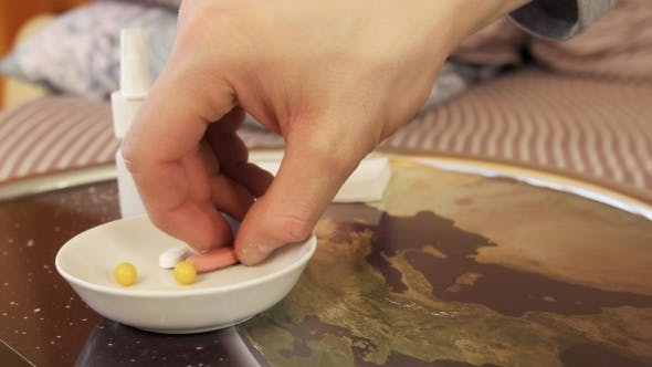 Thumbnail for Hand Is Taking Pharmaceutical Pill From Plate