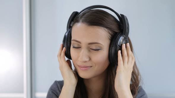 Thumbnail for Woman Puts On, And Takes Off The Headphones