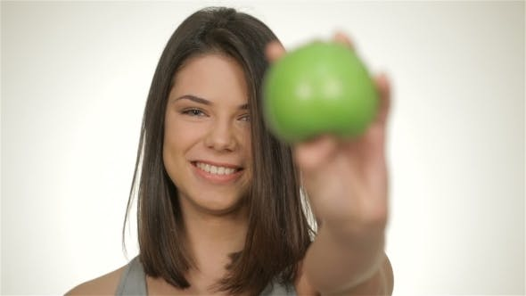 Thumbnail for Girl Holds Green Apple