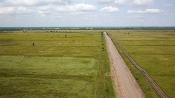 Thumbnail for Aerial Shot Of Car On The Rural Road