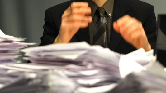Thumbnail for A Businessman Gets Lots of Paperwork