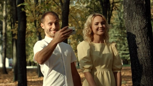 Thumbnail for Smiling Couple Making Selfie In Autumn Park