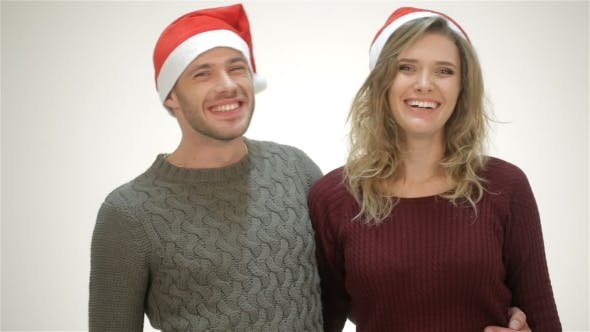 Thumbnail for Happy Couple In Santa Hat Laughs While Standing In