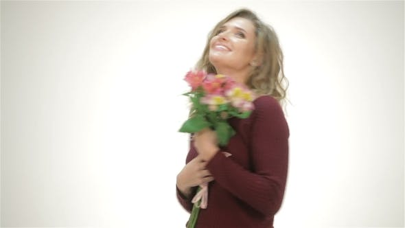 Thumbnail for Happy Girl With a Bouquet Of Flowers