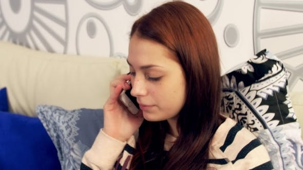 Thumbnail for Pretty Young Girl Talking On Phone In Bed