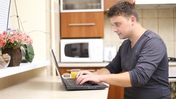 Thumbnail for Man With a Laptop In The Kitchen