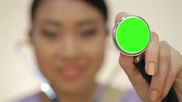 Cover Image for Asian Doctor Holding a Stethoscope