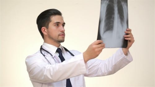 Respectable Male Doctor Examines An X-ray