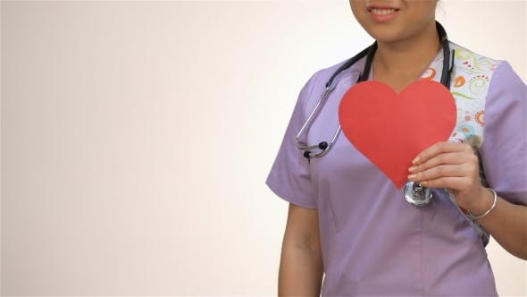 Thumbnail for Asian Girl Nurses Holding a Paper Heart