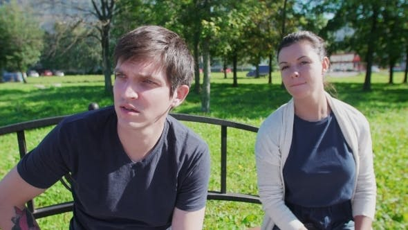 Thumbnail for Happy Couple Talking, Smiling In Park Bench