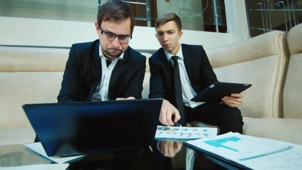 Thumbnail for Two Businessman Working At a Laptop