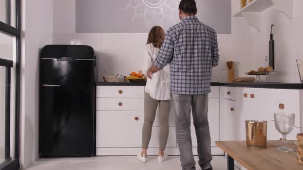 Thumbnail for Loving Husband Caressing Pregnant Woman in Kitchen