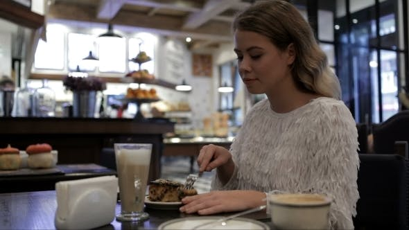 Thumbnail for Nice Girl Eating Yummy At The Cafe