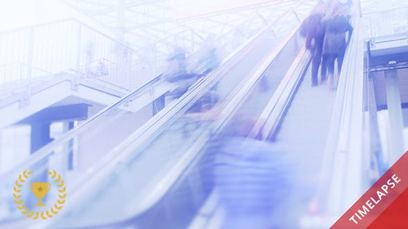 Thumbnail for People on Escalators in Shopping Center
