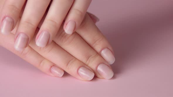 Thumbnail for Closeup Woman Hand on Pink Makes Manicure for Herself