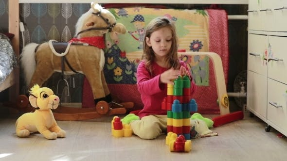 Thumbnail for Cute Little Girl Playing With Toy Blocks At Home