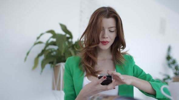 Cover Image for Young Woman Using Phone In Cafe
