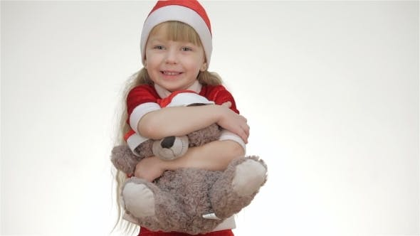 Thumbnail for Kid Girl Hugging a Teddy Bear.