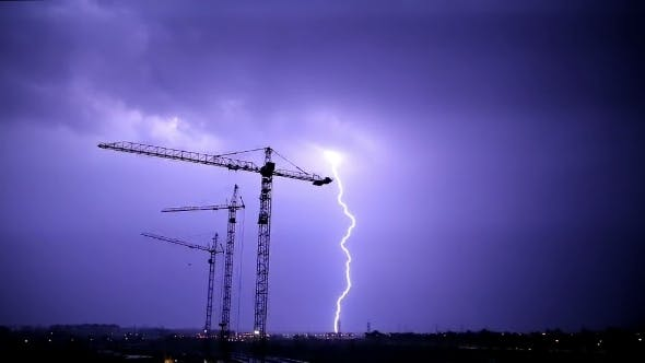 Stormy Sky And Lighnings Over Night Construction