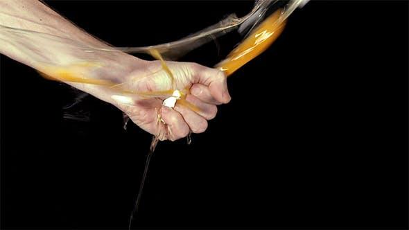 Hand Crushing An Egg