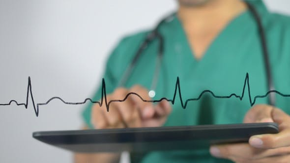 Cover Image for Doctor Working on Tablet. Electrocardiogram.