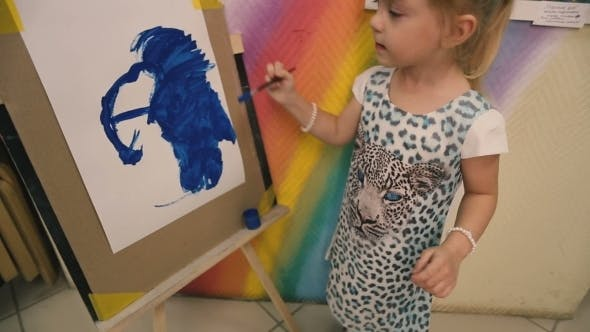 Thumbnail for Little Girl Draws a Blue Paint On Paper.