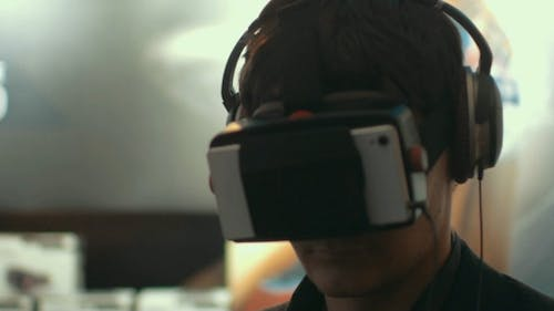 Man Using Augmented Reality Device For Mobiles