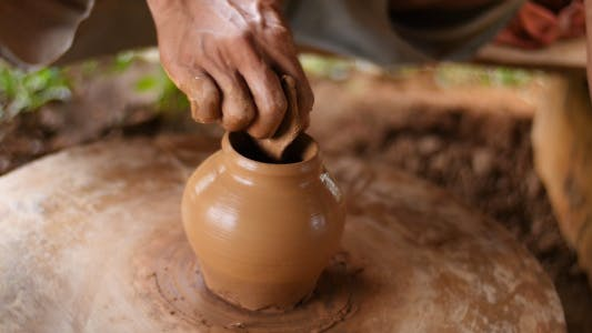 Hands Working On Pottery