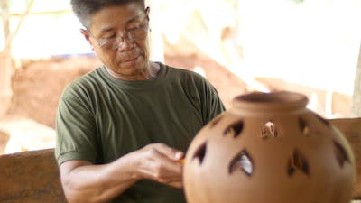 Old Man Carving Earthenware