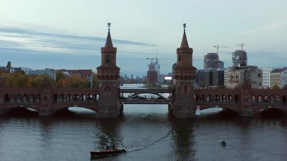 Aerial Establishing Shot of Through 2 Towers of Oberbaum Bridge in Berlin, Germany Revealing Skyline
