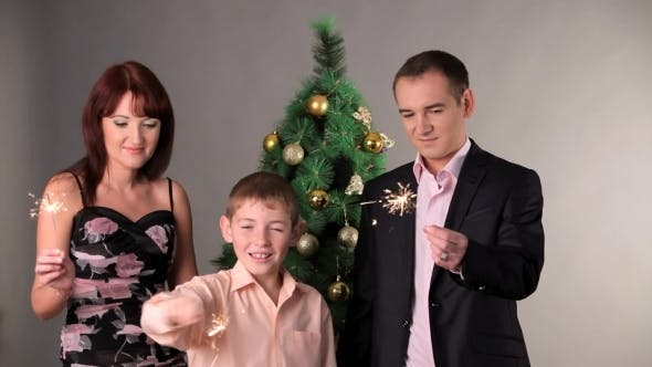 Thumbnail for Happy Family With Sparkles On Christmas