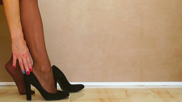 Thumbnail for Woman Putting on Black Shoes