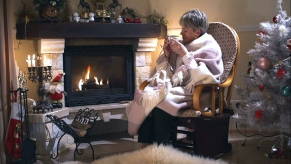 Cover Image for Woman Sitting In a Rocking Chair Near Fireplace