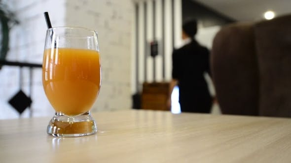 Thumbnail for Glass Of Fruit Juice On  Table In a Cafe