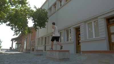 Teenager Performing Parkour In The Street