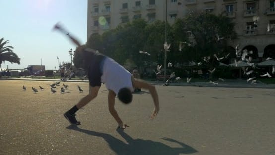 Thumbnail for Teenager Doing Acrobatics On City Square