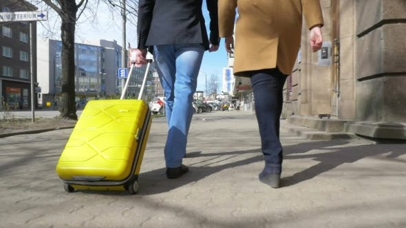 Cover Image for Young Couple With Rolling Bag In The City