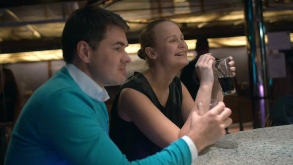 Thumbnail for Young Couple Relaxing In Bar And Having Drinks