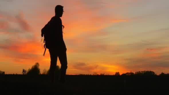 Thumbnail for Man With Backpack Man's Silhouette at The Sunset