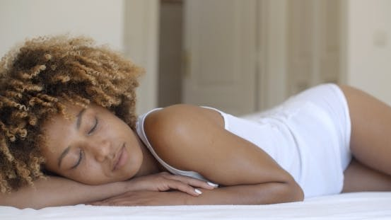 Thumbnail for Young Woman Waking Up From Sleep And Smiling