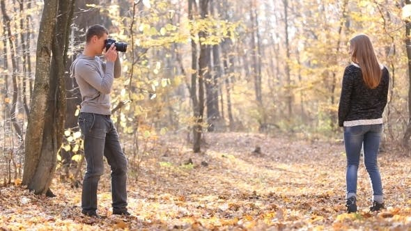 Thumbnail for Man Photographing Woman