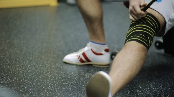 Thumbnail for Male Athletes Aged Rewinds His Knee On The Leg