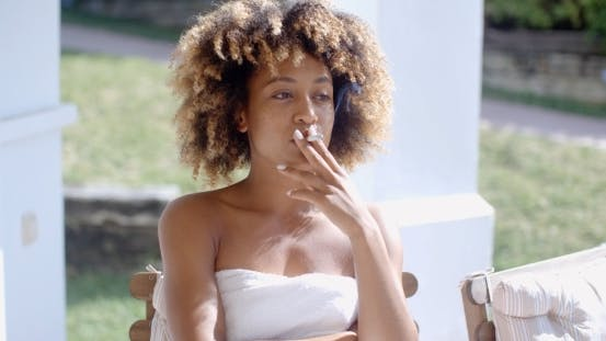 Thumbnail for Woman Sittin On Terrace And Smoking