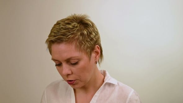 Thumbnail for Pretty Short Hair Girl Looking Down And Considers