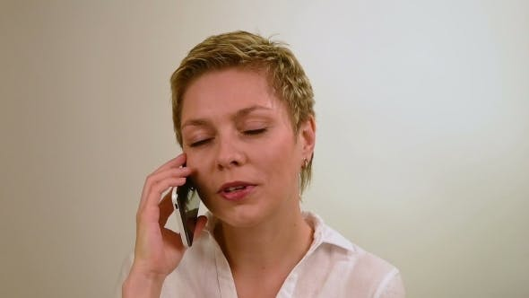 Thumbnail for Pretty Short Hair Girl Talking By Mobile Phone